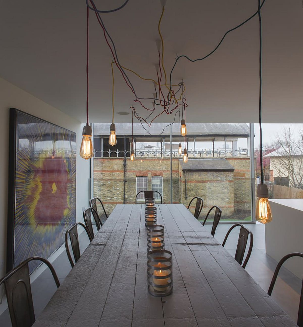 Edison bulb lighting adds industrial touches to this modern minimal dining space