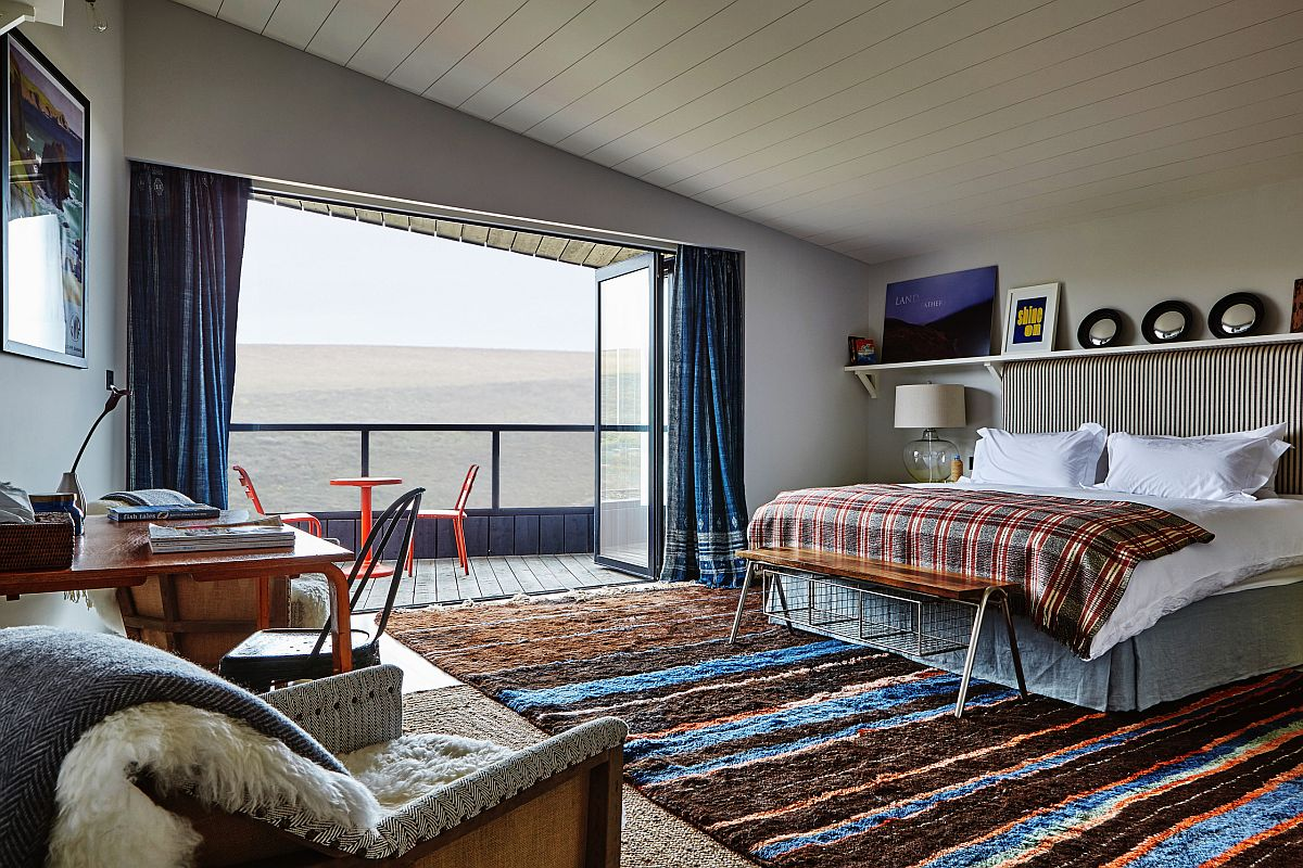 Elegant bedroom with ocean views that veers more towards the modern than the eclectic