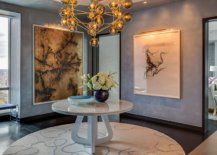 Entry-of-the-model-apartment-welcomes-you-with-a-sparkling-chandeliers-and-a-round-console-table-93021-217x155