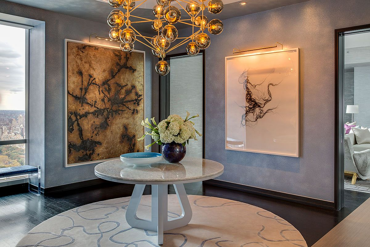 Entry-of-the-model-apartment-welcomes-you-with-a-sparkling-chandeliers-and-a-round-console-table-93021