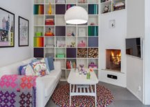 Everything-from-the-eye-catching-rug-to-the-books-on-the-shelves-and-cozy-throws-bring-color-to-this-home-library-86395-217x155
