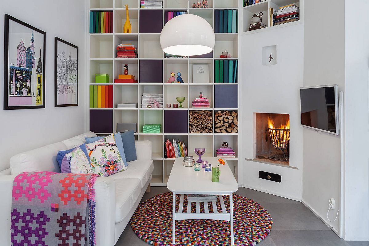Everything from the eye-catching rug to the books on the shelves and cozy throws bring color to this home library