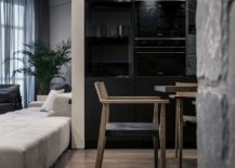 Exposed-natural-stone-is-combined-with-concrete-and-wooden-finishes-inside-the-apartment-99556-217x155