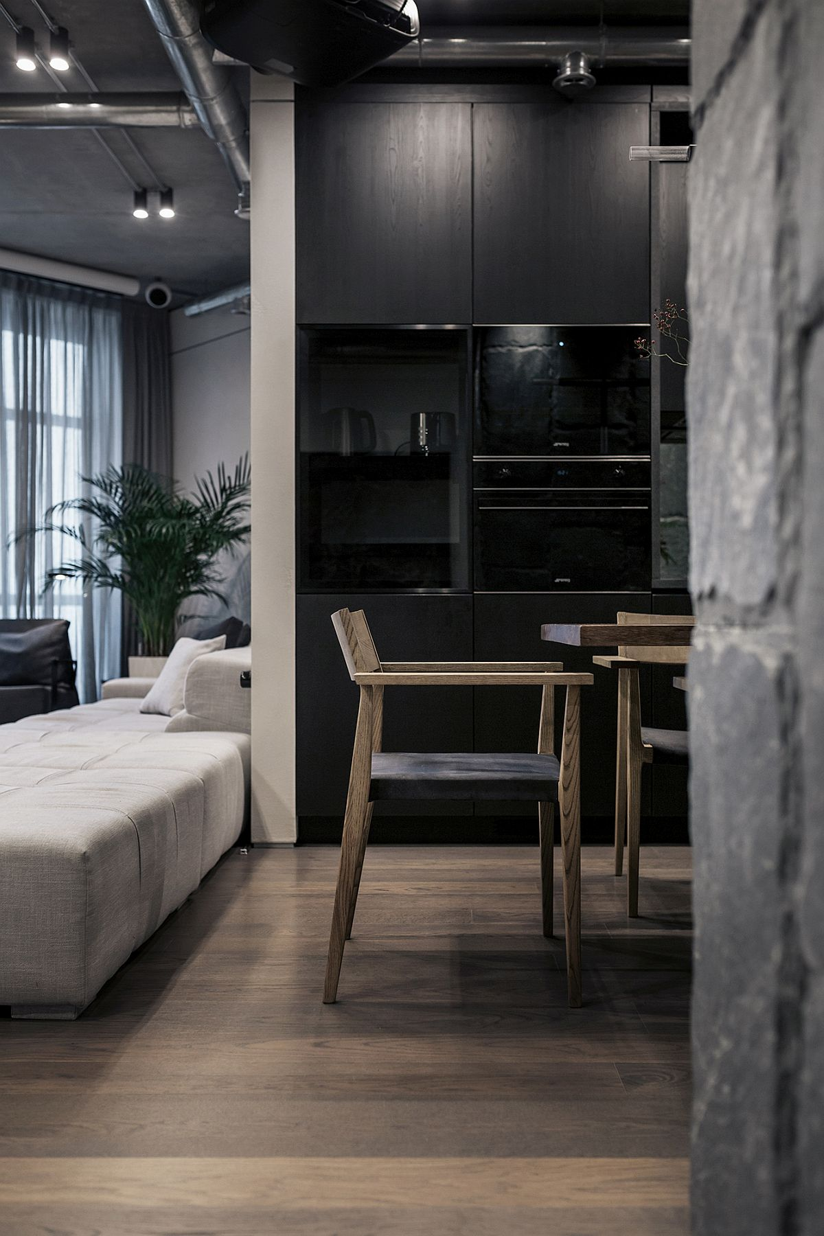 Exposed-natural-stone-is-combined-with-concrete-and-wooden-finishes-inside-the-apartment-99556