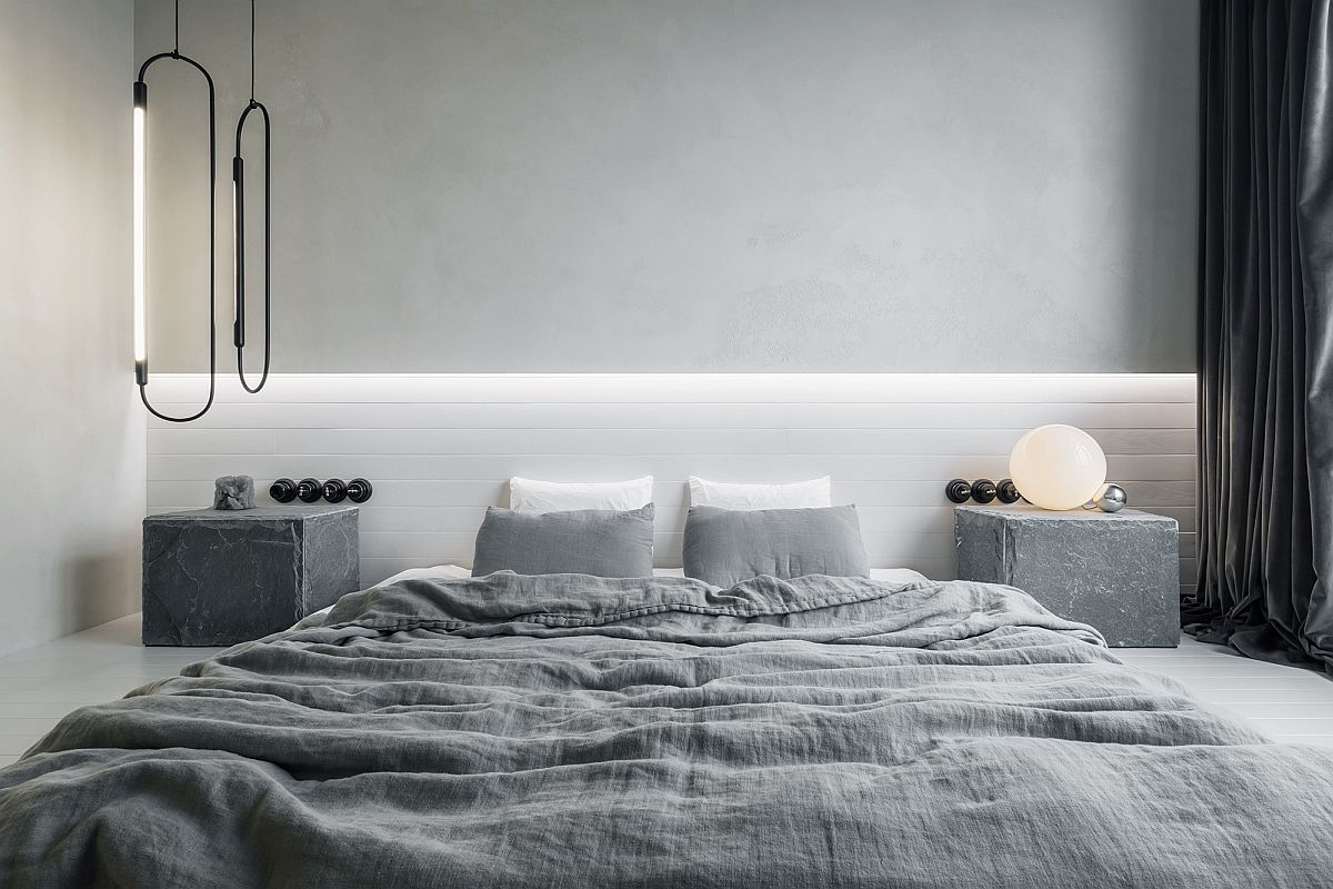 Fabulous bedside pendants and table lamp bring abstratct forms to this minimal bedroom