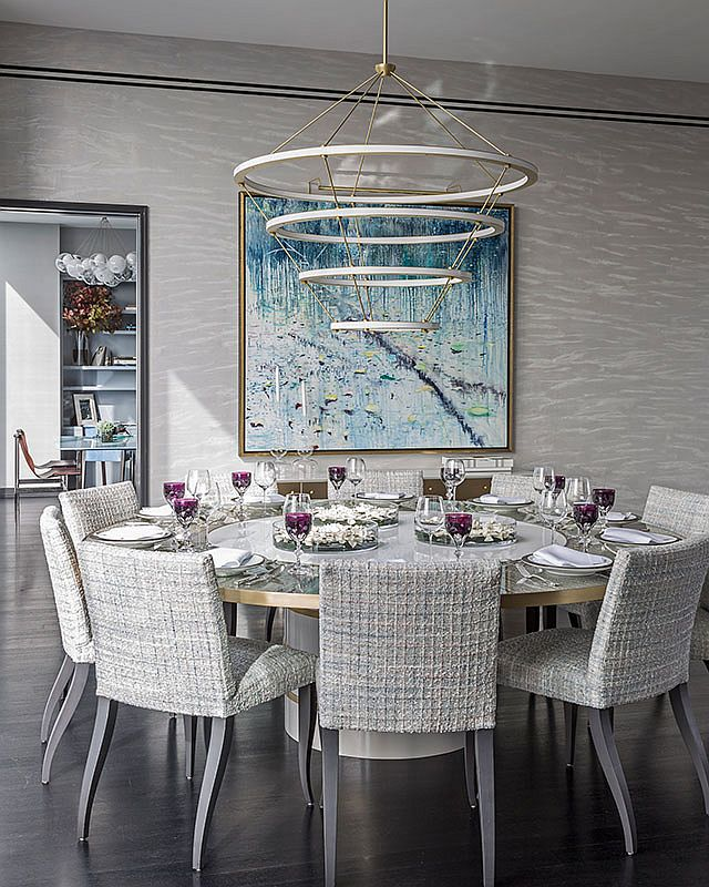 Fabulous-contemporary-dining-room-in-neutral-hues-and-a-round-dining-table-along-with-smart-chandelier-47715
