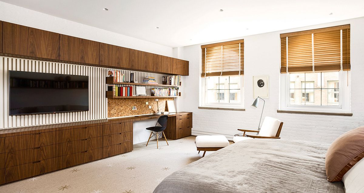 Fabulous custom wooden cabinets and wardrobe along with entertainment unit for the modern bedroom