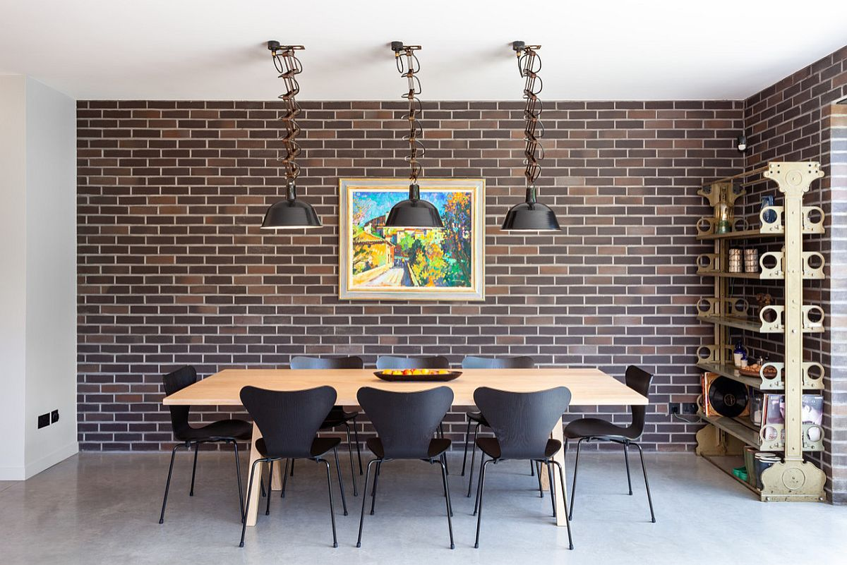 Faux brick walls, mid-century modern chairs and a polished deisgn bring the 50's back in this dining room!