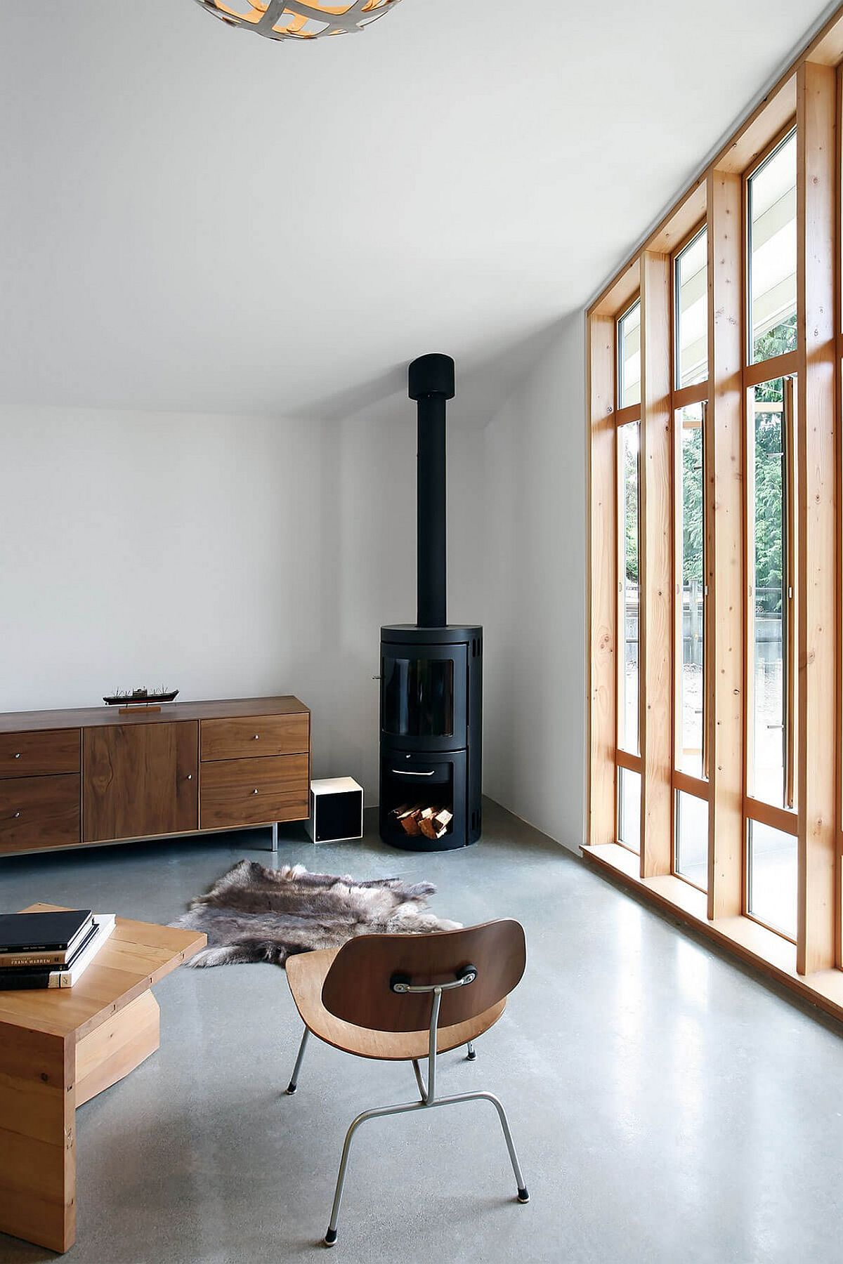 Fireplace in the corner and smart credenza fill the corner of the studio space