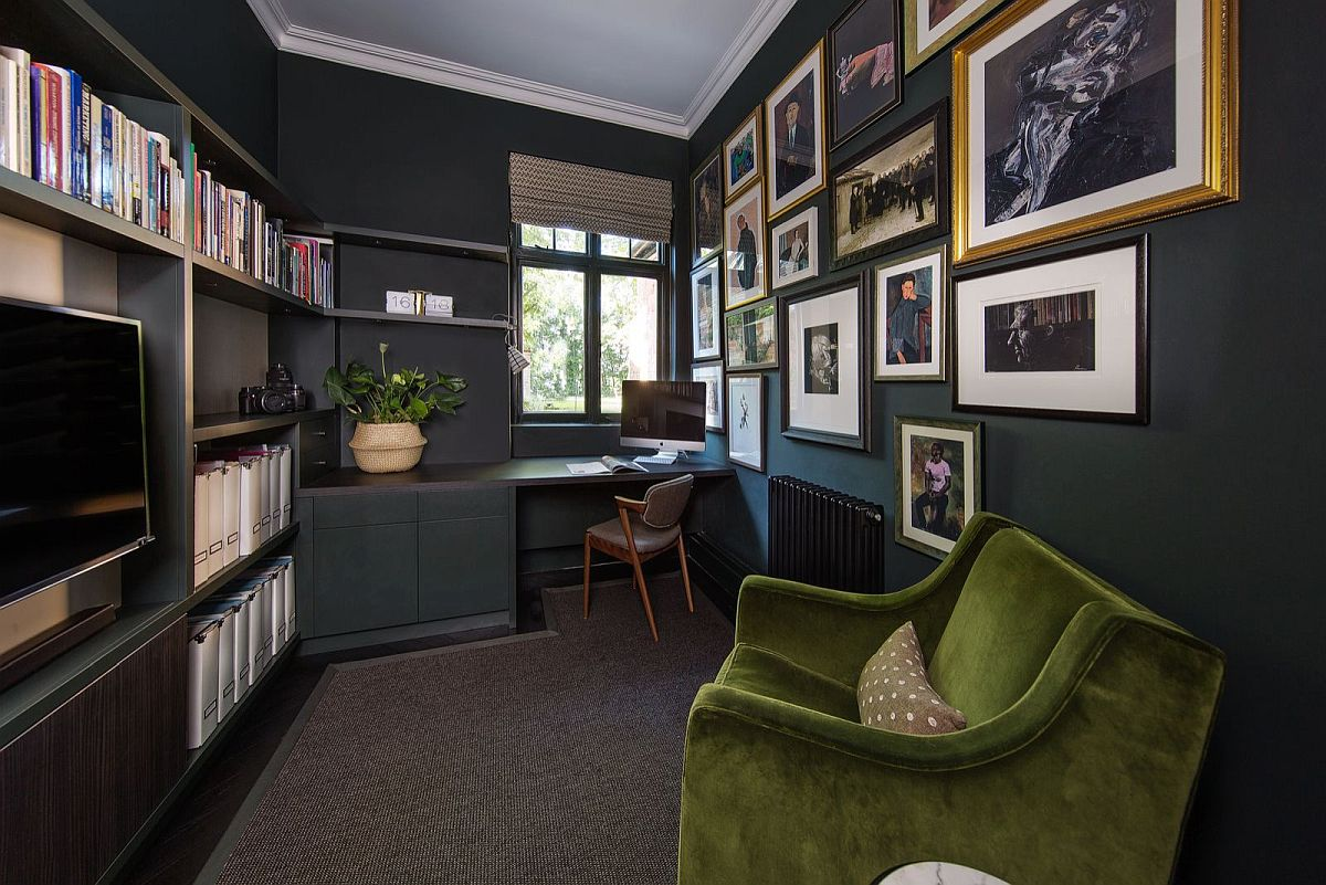 Gallery wall creates an instant focal point in ths black home office