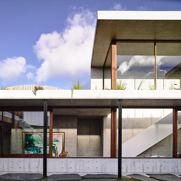 Glass walls connect the interior of the house and the hallways with the exterior outside