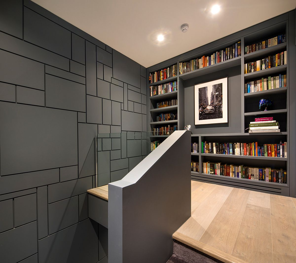 Gorgeous gray walls add to the sophisticated style of this modern bookshelf