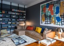 Gorgeous-home-library-with-deep-gray-walls-still-feels-cheerful-thanks-to-the-colorful-wall-art-and-accent-pillows-97824-217x155