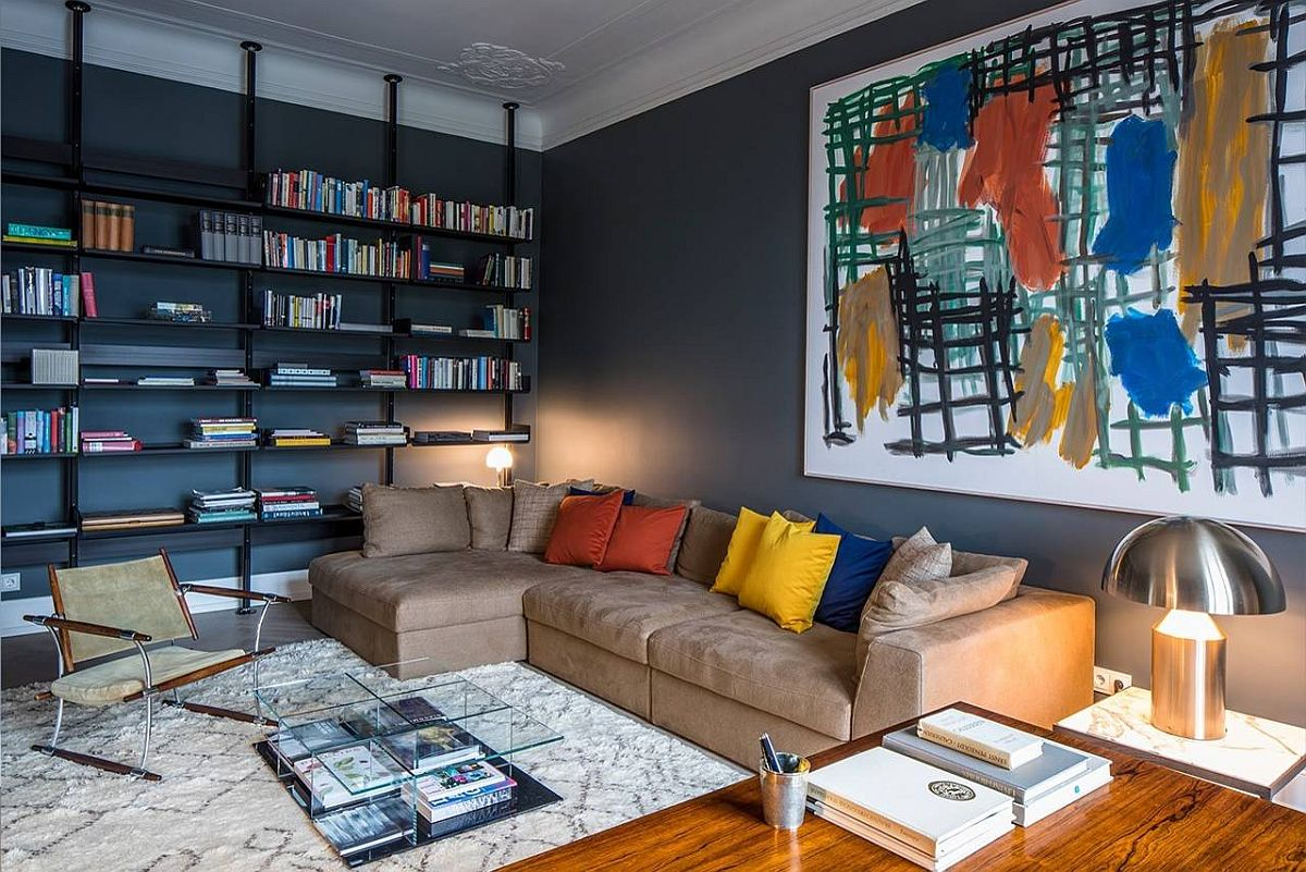 Gorgeous-home-library-with-deep-gray-walls-still-feels-cheerful-thanks-to-the-colorful-wall-art-and-accent-pillows-97824