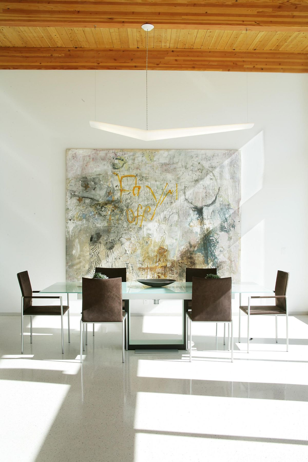 Graffiti brought into the minimal dining room to create more visual interest