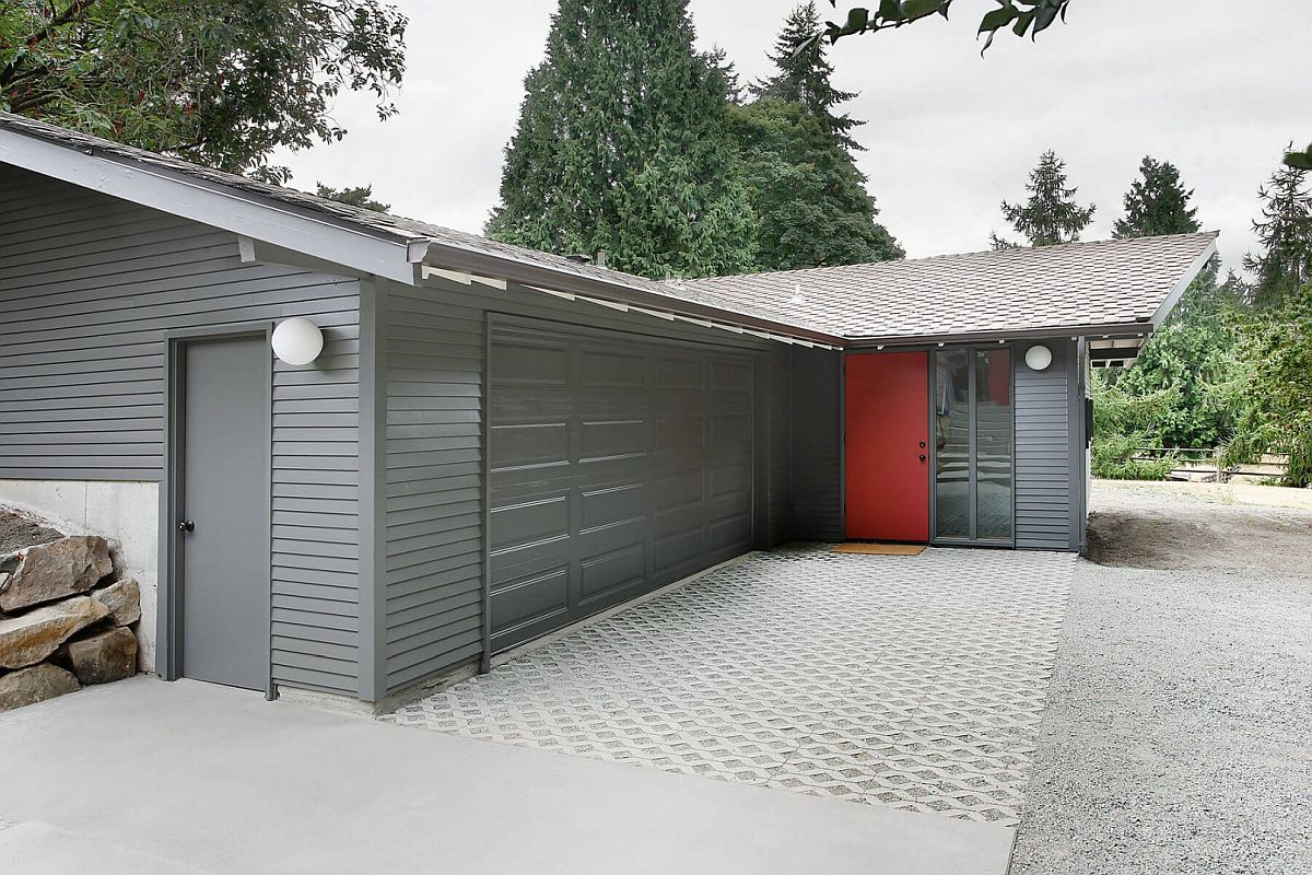Gray gives the exterior a modern appeal with red doors providing visual contrast