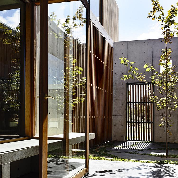 Interior courtyards and gardens create a lovely green refuge inside the confines of the compact suburban home