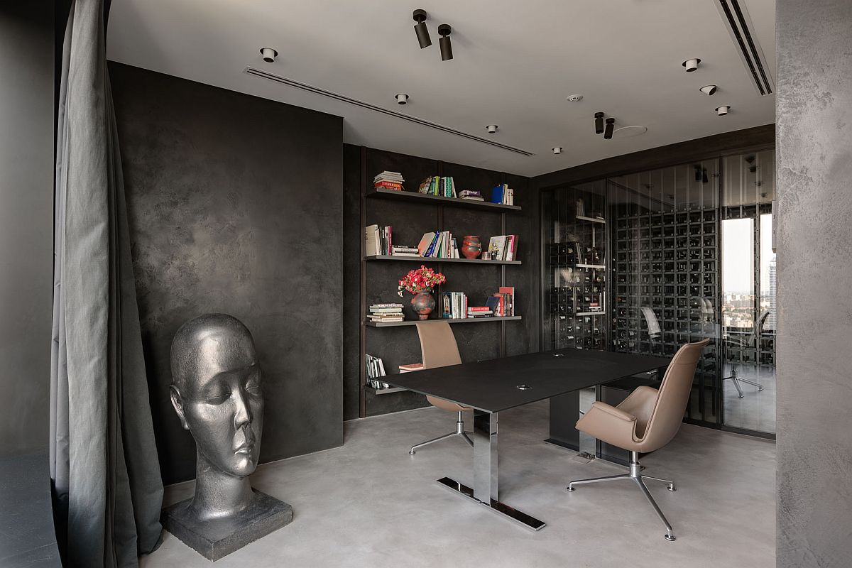 Inventive contemporary home office with textured walls and a dark desk that also adds to the color scheme