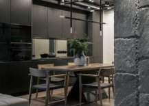 Kitchen-and-dining-area-of-the-apartment-with-lovely-black-cabinets-and-unique-lighting-fixtures-24014-217x155