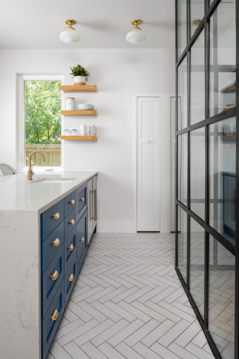 Kitchen with white herringbone floor tiles