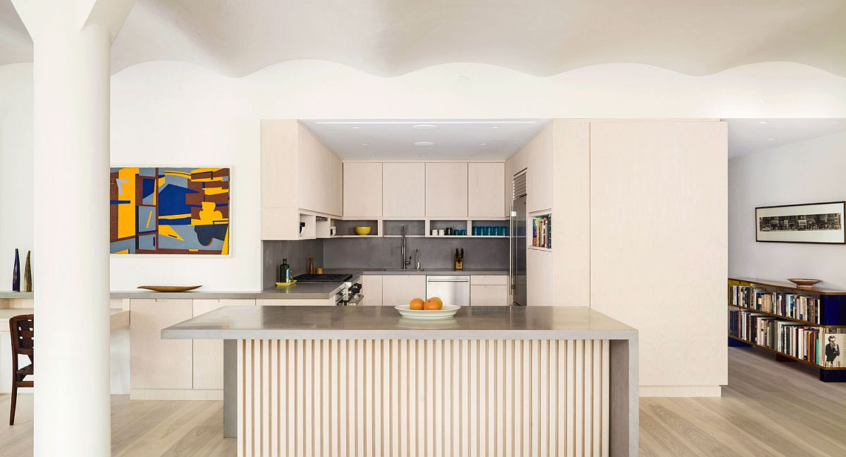 Large niche inside the apartment contains the space-savvy and stylish modern kitchen