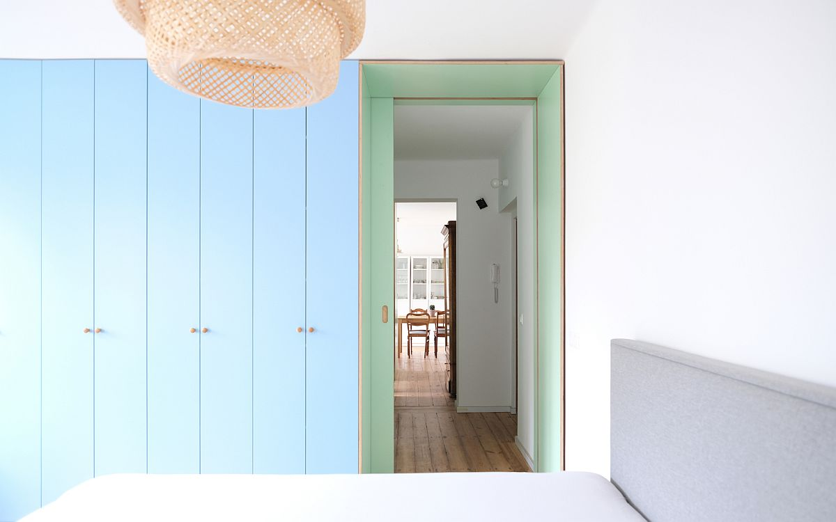 Living-area-sits-at-one-end-of-the-narrow-apartment-and-bedroom-at-the-other-11919