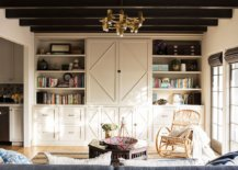 Living-room-of-the-home-with-open-shelves-closed-cabinets-and-exposed-wooden-beams-60061-217x155