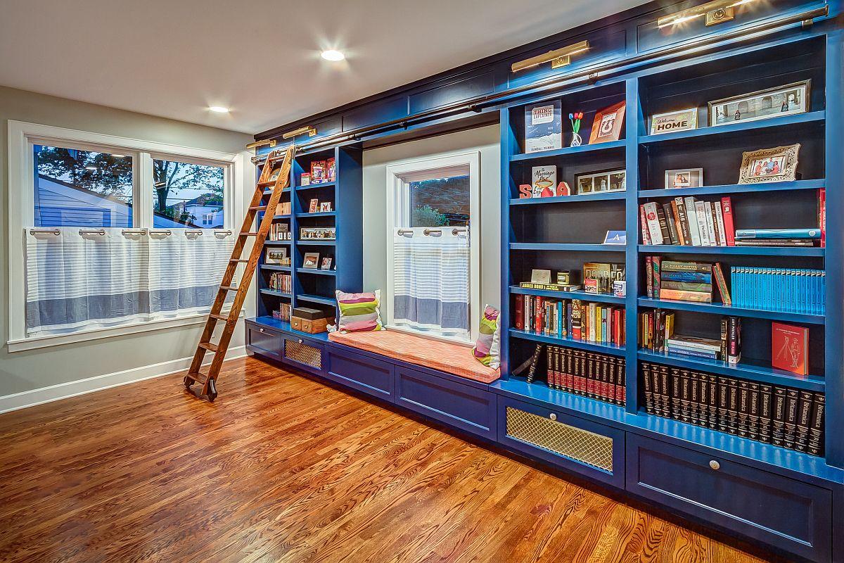 Lovely custom built-in bookshelves in blue for the modest home library