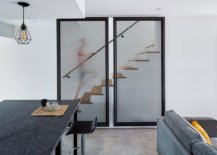Metallic-mesh-structures-hide-the-staircase-leading-to-the-upper-level-of-the-house-26882-217x155