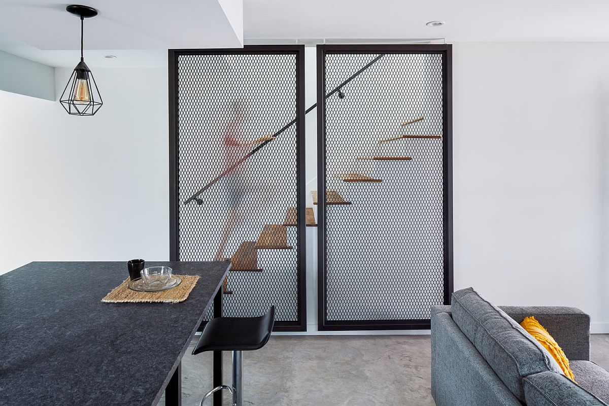 Metallic-mesh-structures-hide-the-staircase-leading-to-the-upper-level-of-the-house-26882