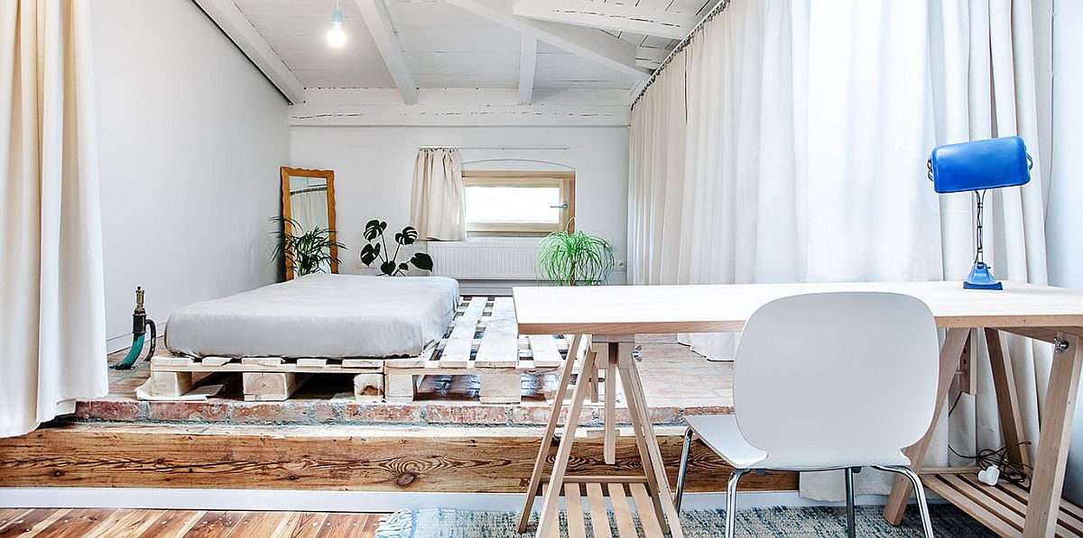 Minimal platform bed is perfect for the low ceiling of the attic bedroom with a modern style