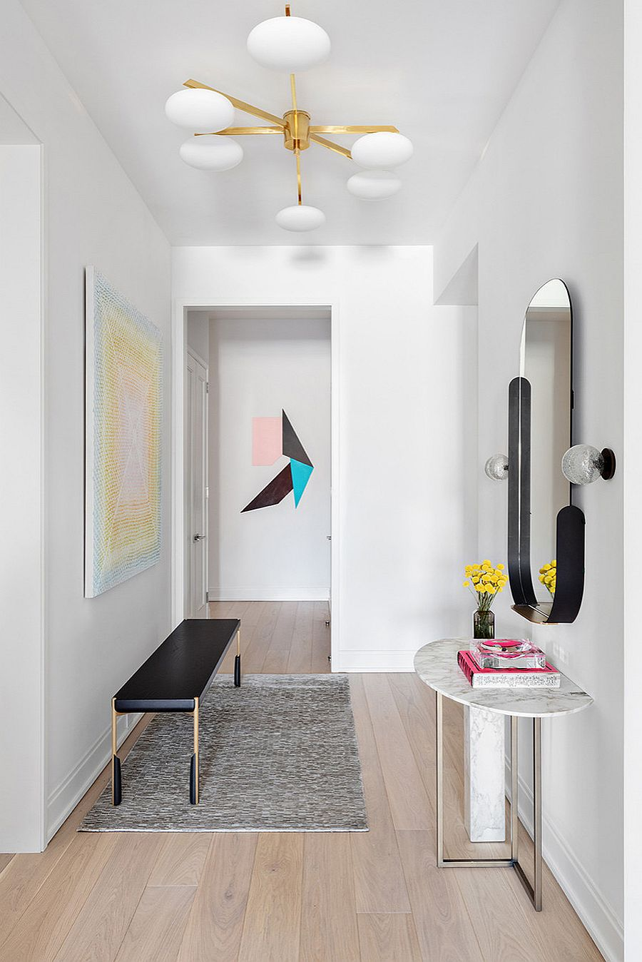 Mirror, fabulous console table and another slim bench are used to decorate this smart hallway
