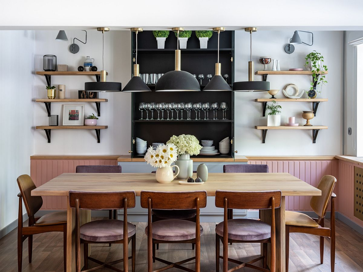 Modern and mid-century influences come together beautifully in this gorgeous dining room with open shelves
