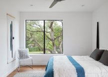 Modern-bedroom-in-white-of-the-Texas-home-with-simple-blue-accents-84049-217x155