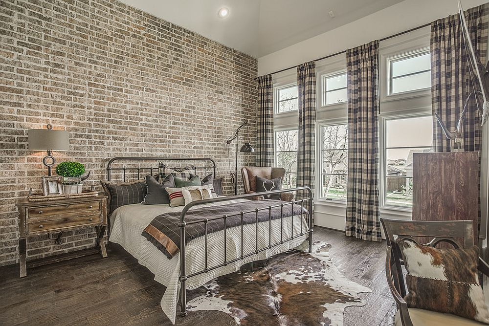 Modern industrial bedroom with exposed brick wall and cutains with plaid pattern