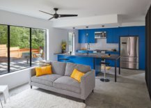 Modern-kitchen-inside-he-Texas-home-with-bright-blue-cabinets-and-a-relaxing-sitting-area-next-to-it-20855-217x155