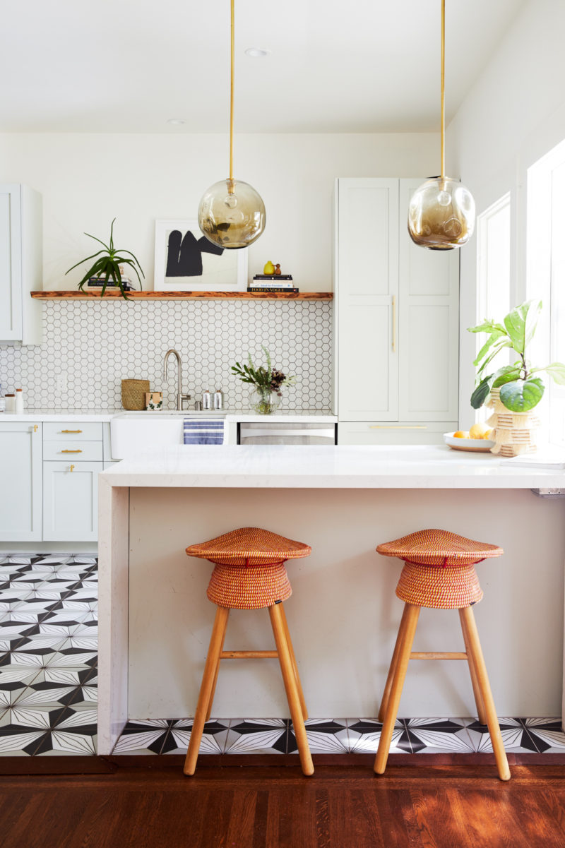Modern kitchen with black and white patterned floor tile
