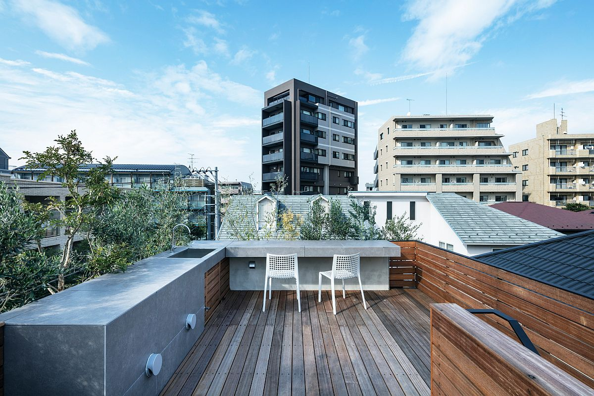 Modern minimal rooftop kitchen combines polished exposed concrete finishes with wood