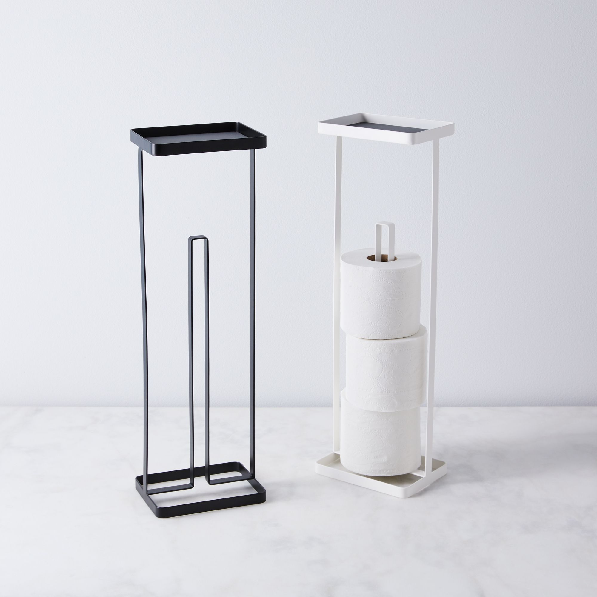 Modern toilet paper stands in black and white