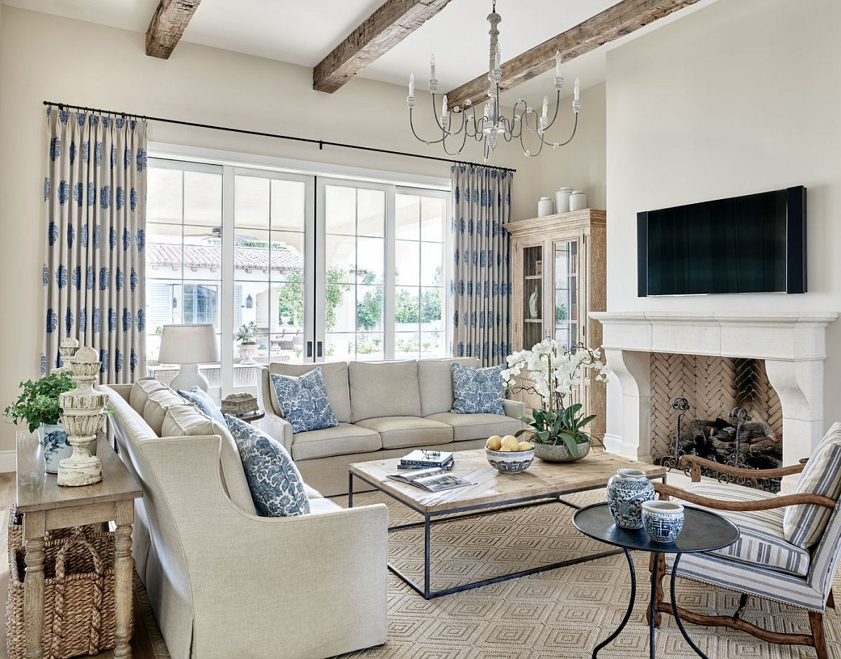Modern traditional living room of the revamped home in white with gorgeous blue accents