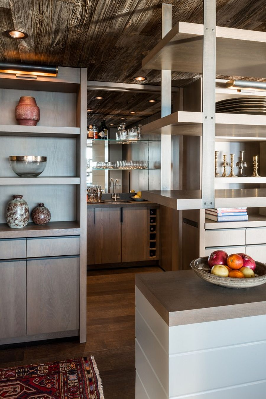 Multiple open shelves and closed cabinets create a flexible and functional modern kitchen