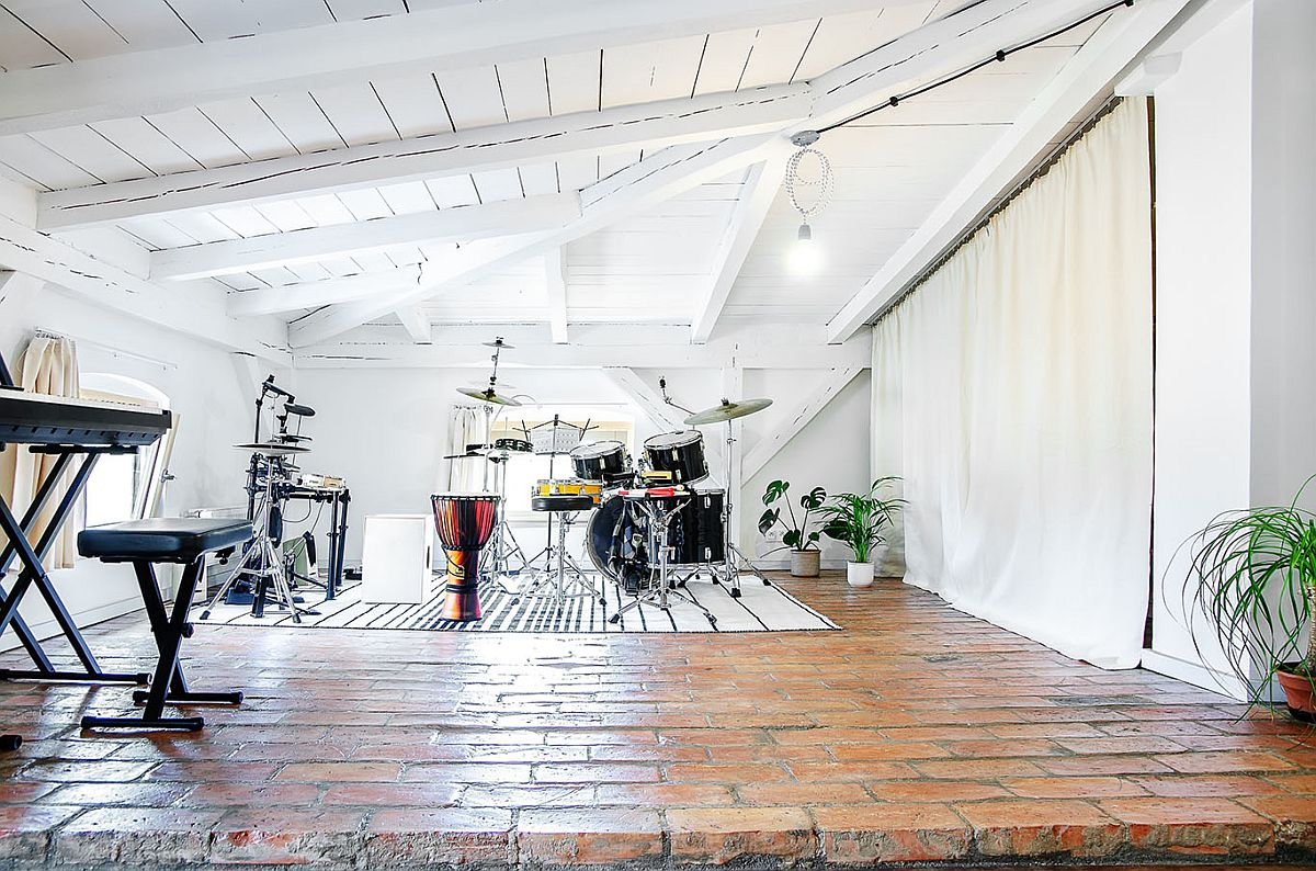 Music studio in the attic is a perfect addition that keeps out noise from rest of the house