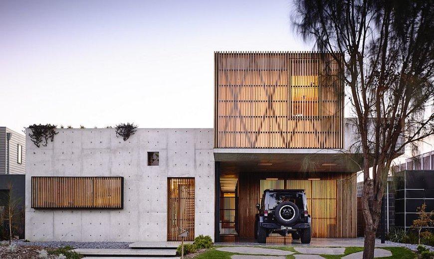 Hardwood and Concrete Create a Suburban Sanctuary that Opens Towards Wetlands