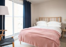 Navy-blue-drapes-and-pink-bed-sheets-usher-color-into-this-Scandinavian-style-bedroom-53537-217x155