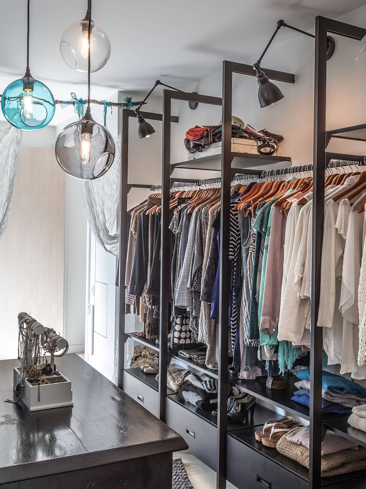 Open closets and lovely lighting shape this fabulous walk-in closet in Toronto home