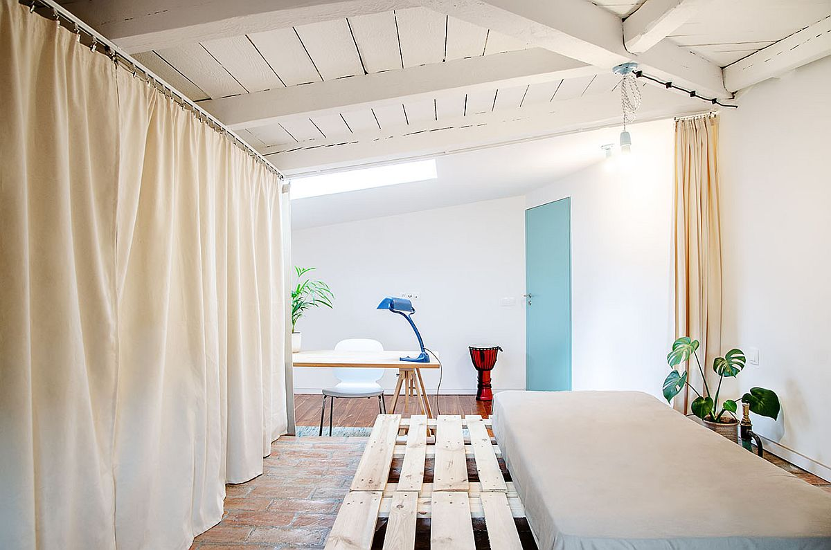 Original wooden ceiling of the attic has been preserved and enhanced to add textural contrast to the space