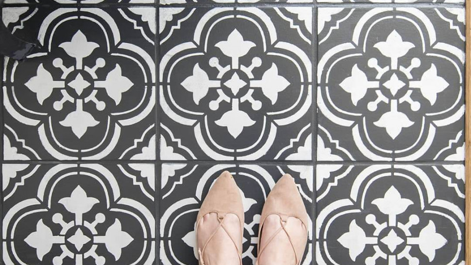 Painted ceramic floor tile in black and white