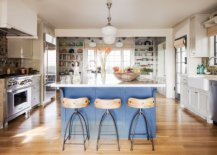 Pattern-filled-tiled-backsplash-and-a-gorgeous-blue-island-bring-color-into-this-kitchen-with-modern-and-Spanish-influences-10019-217x155