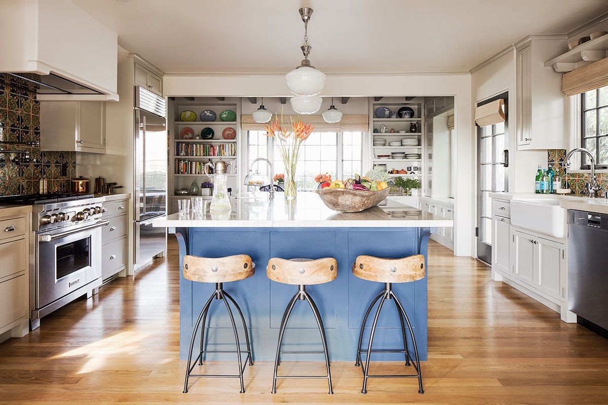 Pattern-filled-tiled-backsplash-and-a-gorgeous-blue-island-bring-color-into-this-kitchen-with-modern-and-Spanish-influences-10019