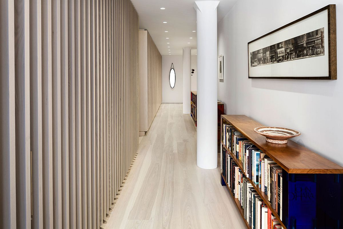Plaster walls and a white and ash color scheme give the interior a modern makeover